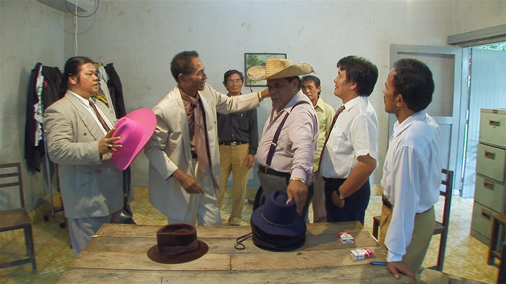 Anwar and friends assume their characters in a scene from The Act of Killing